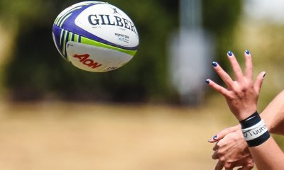 Rugby ball and fingernails. Womens rugby