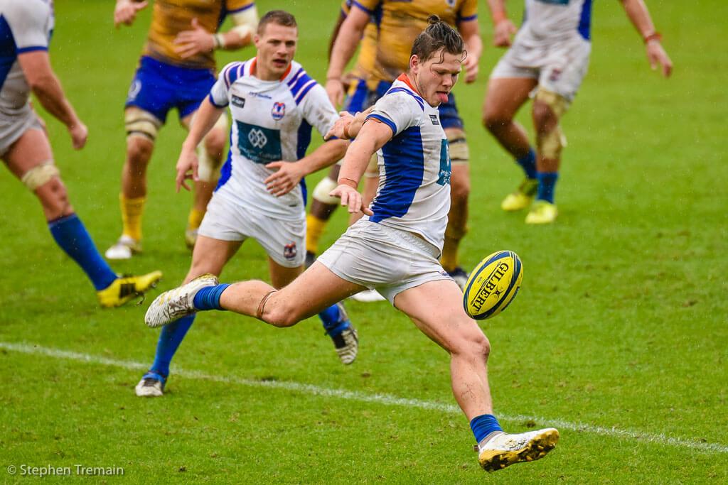 Greater Sydney Rams clear the ball