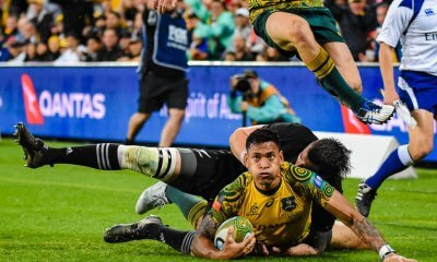 Israel Folau scores despite the tackle of Liam Squire