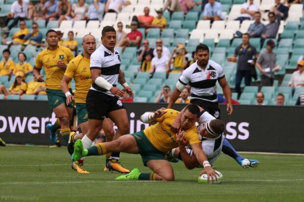 Duncan Paia'aua scoring the first try of the game.