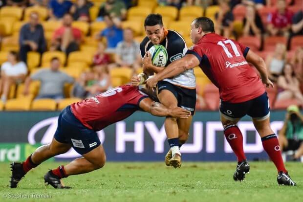 Wharenui Hawera tries to break the tackle of Alex Mafi and JP Smith