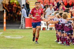 Chris Feauai-Sautia leads the Reds out in his 50th game