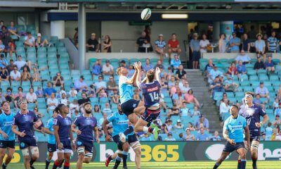 Folau competes for a high ball.