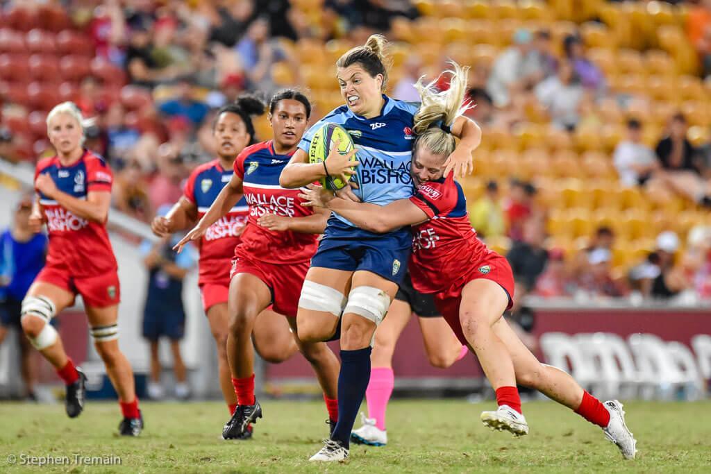 Grace Hamilton tackled by Sammie Treherne