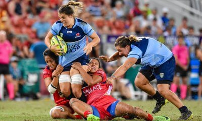 Kirby Sefo and Liz Patu struggle to bring Grace Hamilton down