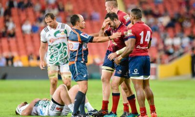 Jono Lance steadied by teammates, after a head-knock with a Chiefs player, as Jaco Pyper checks him out.
