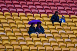 A few brave souls sit out the rain