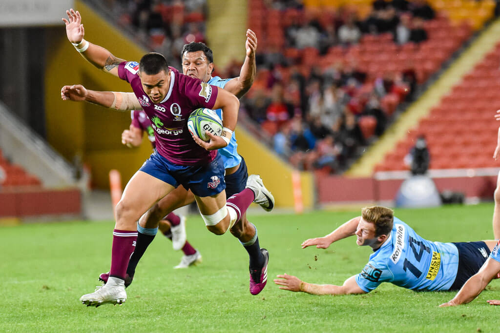 Kurtley Beale about to wrap up Duncan Paia'aua