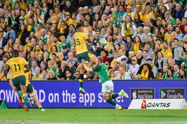 Israel Folau charges down a kick