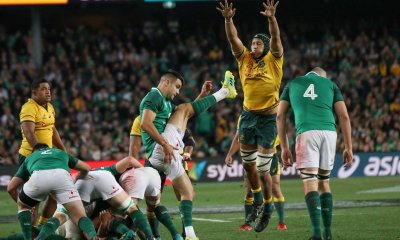 Adam Coleman attempts a charge down on Conor Murray,