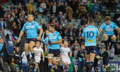 The Waratahs run out to face the highlanders.
