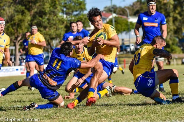 Karmichael Hunt is tackled by Rod Davies