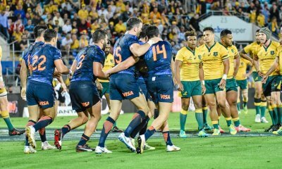 Puma's celebrate a try, watched by the Wallabies