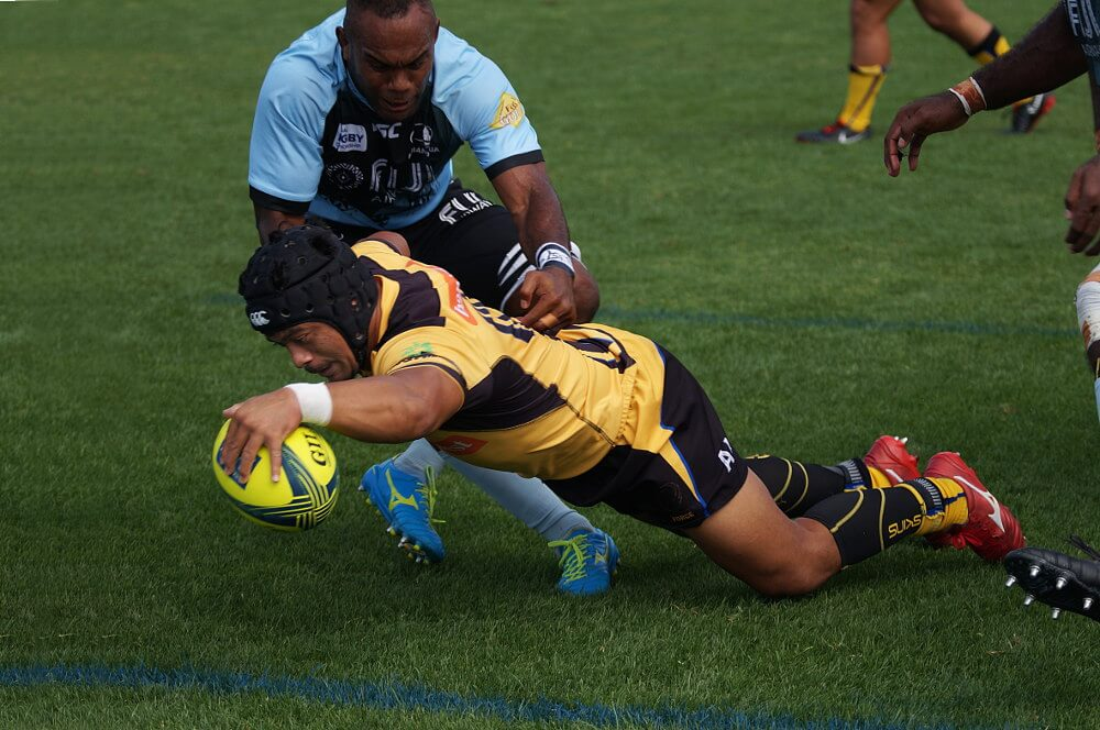 Rodney Iona barges over for an important try