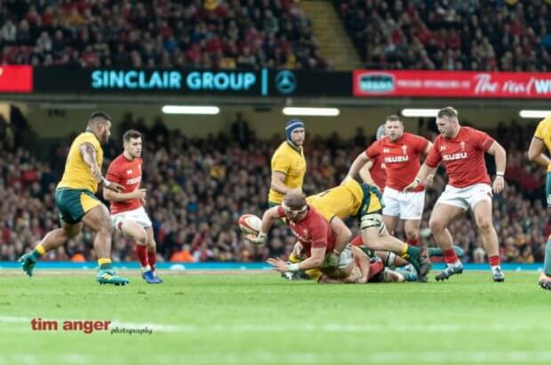 Welsh captain, Alun Wyn Jones flicks a pass back as he is tackled.