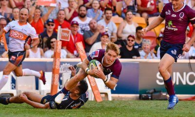 Tate McDermott scores a try