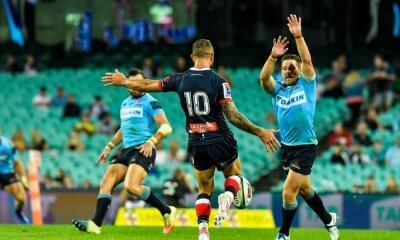 Quade Cooper kicks over Bernard Foley Waratahs v Rebels 2019 (Credit Keith McInnes)
