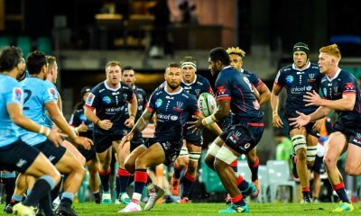 Quade Cooper offloads to Isi Naisirani Waratahs v Rebels 2019 (Credit Keith McInnes)