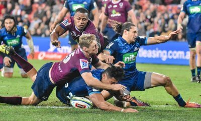 Samu Kerevi and Bryce Hegarty fight for a loose ball