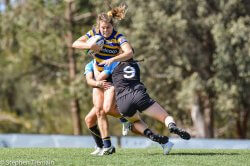 Grace Hamilton of University of Sydney is tackled