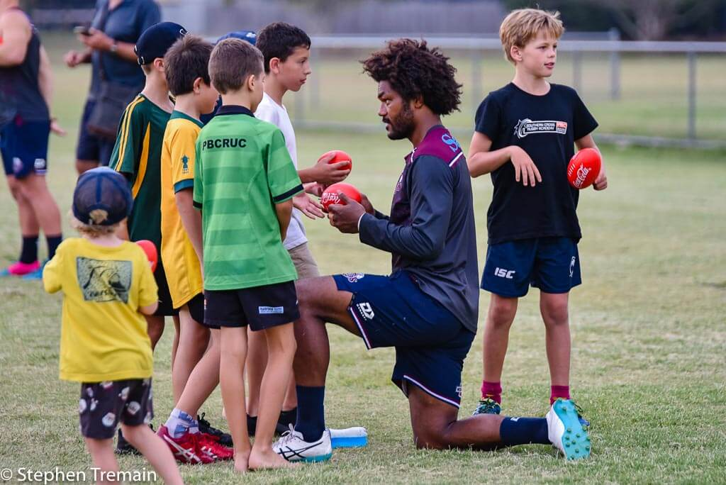 Henry Speight signs some mini-footballs for the Alleygators juniors