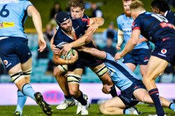 Michael Wells is tackled by Michael Hooper Waratahs v Rebels Super Rugby 2020 (Credit - Keith McInnes Photography)