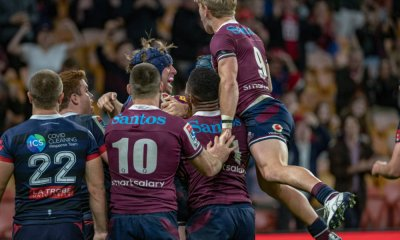 Tate McDermott jumps on celebrating Reds v Rebels 2020 Super Rugby (CREDIT: Brendan Hertel/QRU)