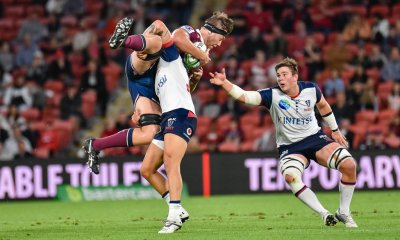 Angus Blyth is tackled by Billy Meakes