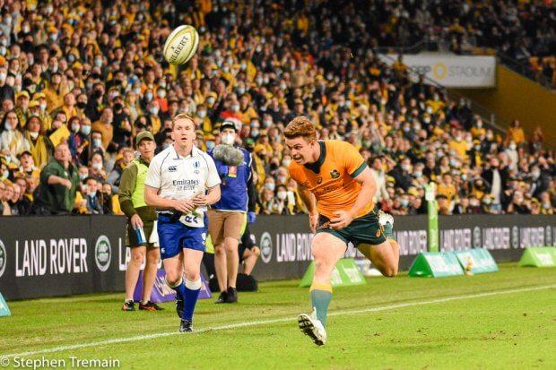 Hunter Paisami's cross kick goes just over Andrew Kellaway's head